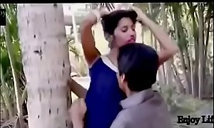 Indian Teen kissing at garden